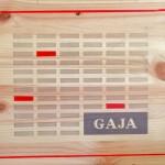 Gaja, 2017, poesia visiva, intervento in acrilico su coperchio di confezione di vini